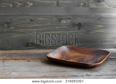 Brown Square Flat Wooden Empty Plate On The Texutred Natural Table Made From Timber. Normal Angle. H