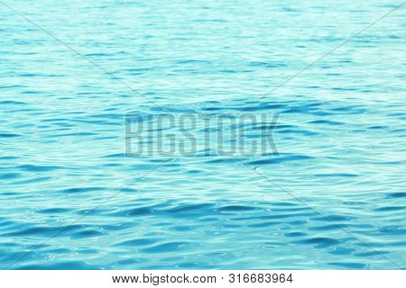 Background Texture Of A Calm Surface Of The Turquoise Sea