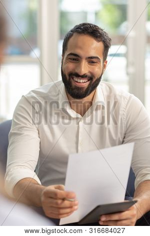 Portrait Of Handsome Man That Reading Agreement