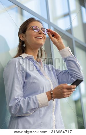 Positive Delighted Young Female Laughing At Joke