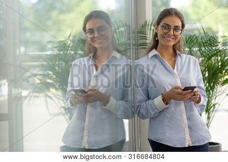 Positive Delighted Brunette Girl Looking At Camera