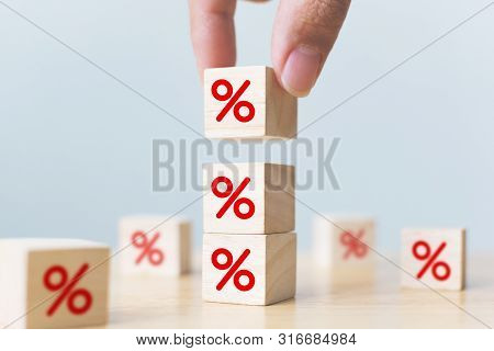 Interest Rate Financial And Mortgage Rates Concept. Hand Putting Wood Cube Block Increasing On Top W