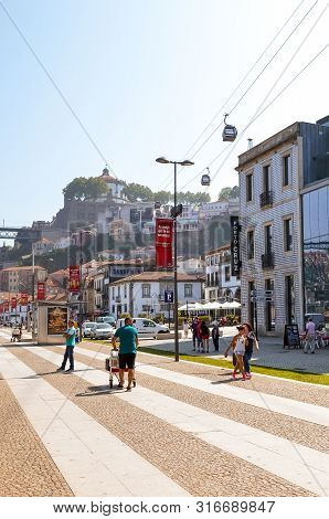 Porto, Portugal - August 31 2018: Tourists Walking On Promenade By River Douro On A Sunny Day. The E