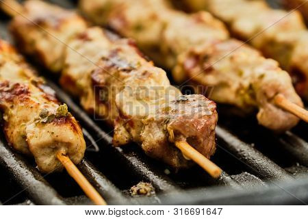 Cooking Tasty Pork Meat Souvlaki On Hot Electric Grill