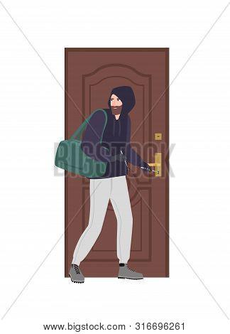 Male Burglar Wearing Hoodie Trying To Unlock Door With Lock Pick And Break In House. Theft, Burglary