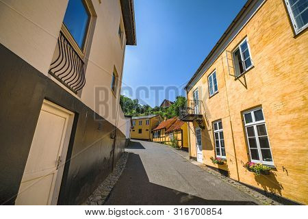 Scandinavian Street With Colorful Buildings In The Summer With Flowers Outside