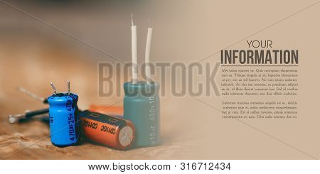 Electrolytic Capacitor Electronic Detal On Wooden Background