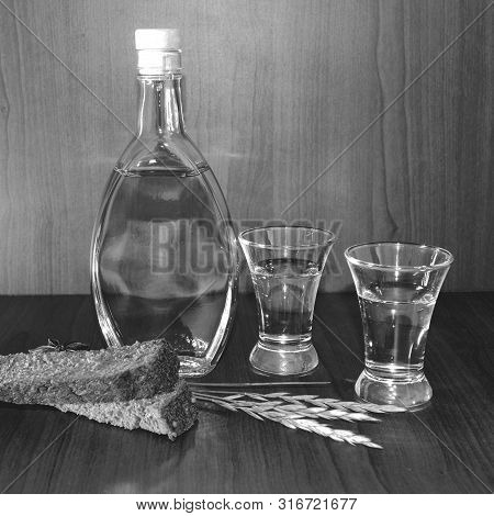 A Glass Of Vodka A Bottle Of Bread And Wheat Spikelets Warm Comfort