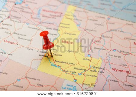 Red Clerical Needle On A Map Of Usa, Idaho And The Capital Boise. Closeup Map Idaho With Red Tack