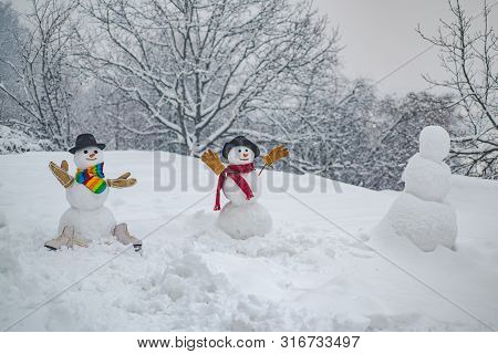 Portrait Snowman In Love. Two Happy Smiling Snowman On Sunny Winter Day. Funny Snowmen. Theme Christ