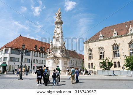 Budapest, Hungary - May 22, 2018: Jesus Cross At Holy Trinity Square In Front Of Matthias Church Cal