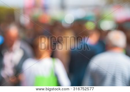 Elderly People As Blur Street Crowd, Unrecognizable Group Of Anonymous Old Men And Women Walking On