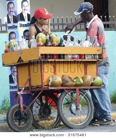 Dominican Rep. election supporter buying from street vendor