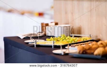 catering on a business conference  Coffee break table on business seminar with fresh bakery,beverage and fruit