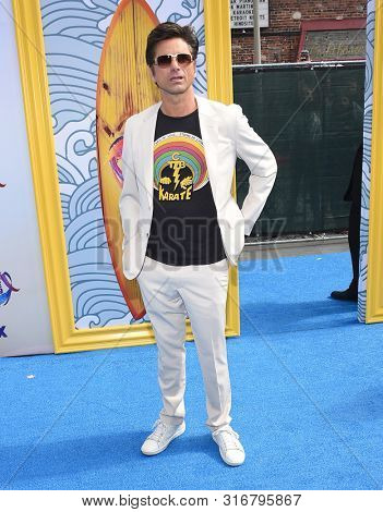 LOS ANGELES - AUG 11:  John Stamos arrives for the 2019 Teen Choice Awards on August 11, 2019 in Hermosa Beach, CA