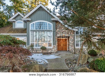 Houses in suburb at Winter in the north America. Luxury houses covered nice snow