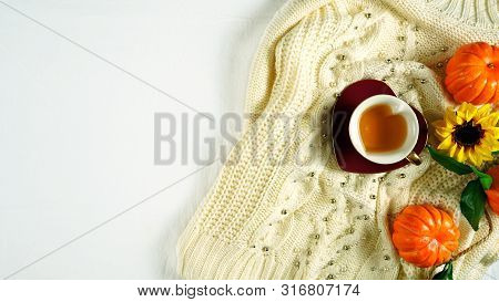 Autumn Fall Theme Flatlay With Cozy Sweater, Bagels And Cups Of Herbal Tea.