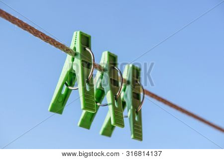 The image of the clothespins close up