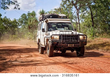 Western Australia – Outback track with 4WD car at the at the savanna