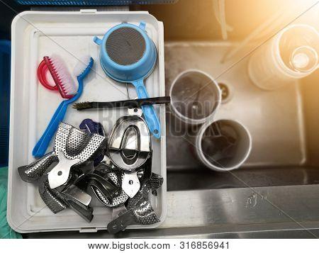 Procedure To Clean Dental Equipment On Sink In The Dental Department.dental Tools,dental Instruments