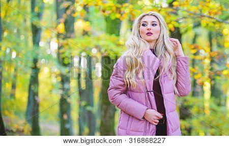 Girl Fashionable Blonde Walk In Autumn Park. Autumn Hair Care Concept. Autumn Hair Care Is Important