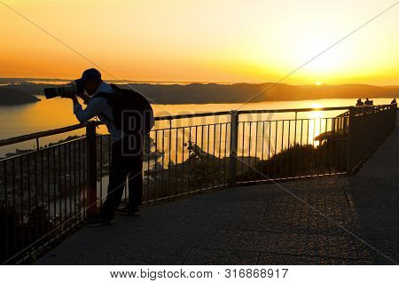 Bergen, Norway - July 25, 2019: Beautiful Landscape, Tourist Taking Photos And Sunset Seen From The