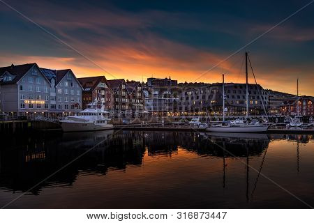 Tromso, Norway - August 17, 2016: View Of The Sunset Over The Tromso Harbor. Tromso Lies In Northern