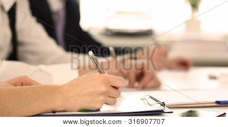 Focus On Tender Female Hand Holding Pen. Directors Signing Biz Documents Discussing Stipulation Of C