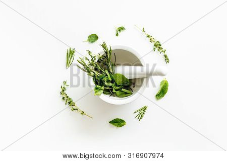 Alternative Medicine With Medicinal Herbs On White Background Top View