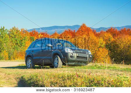 Mizhhirya, Ukraine - Oct 14, 2018: Hyundai Tucson Suv On The Gravel Country Road Side In Mountains.