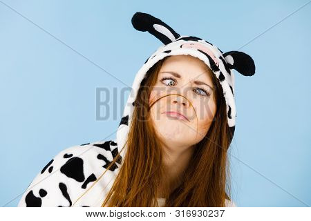 People Dressed Up Like Animals Concept. Happy Crazy Woman In Funny Cow Pajamas Costume