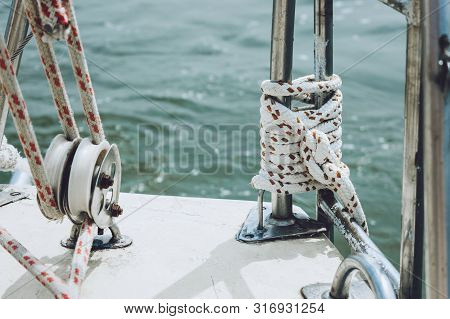 Rope On A Yacht. Yacht Rope Cleat And Sunlight. Sailboat Winch And Rope Yacht Detail. Yachting