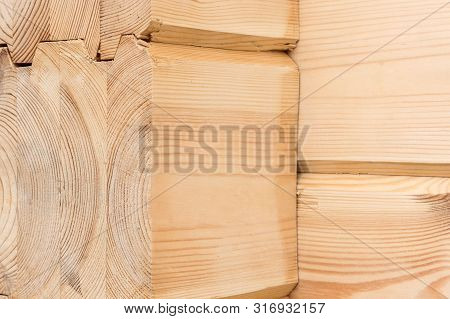 Wood Glued Timber Close Up. Wooden Grain Timber End Background. Glued Pine Timber Beams. Wood For Bu