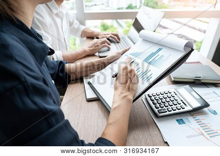 Businessman Discuss Explaining New Trends Information On A Document With Colleague Co-worker Or Part