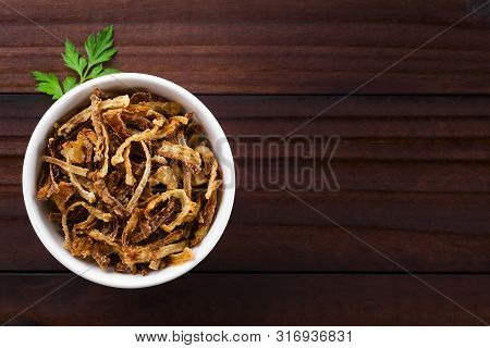 Fresh Homemade Crispy Fried Onion Strings In Bowl, Photographed Overhead With Copy Space On The Side