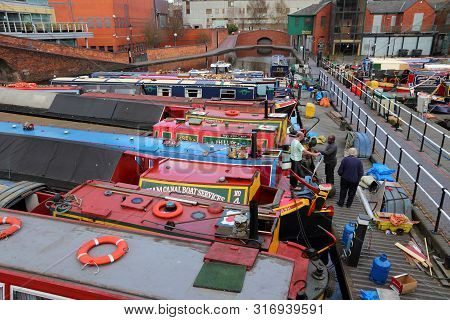 Birmingham, Uk - April 19, 2013: Narrowboats Moored At Gas Street Basin In Birmingham, Uk. Birmingha