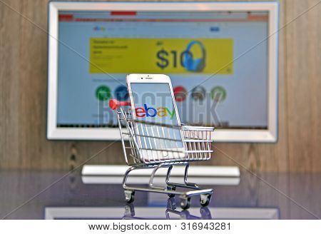 Mobile Phone And Computer Screen With Logo Of Ebay
