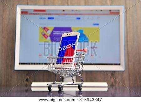 Smartphone With Ozon Logo In Small Shopping Cart