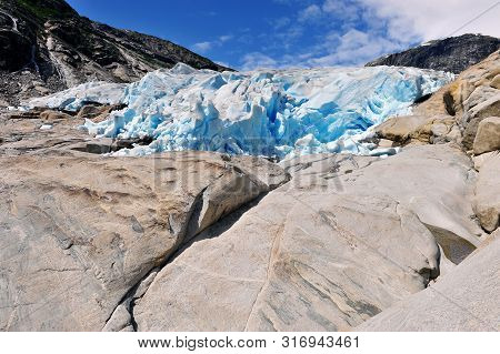 Scenic View Of Nigardsbreen Glacier In Mountains