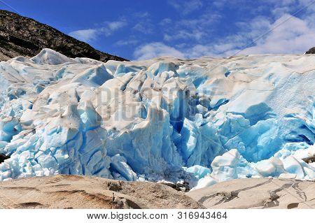 Amazing Blue Ice Of Nigardsbreen Glacier