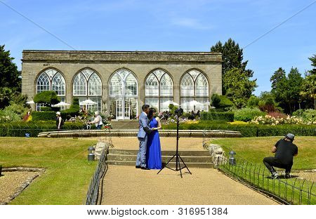 Warwick, Warwickshire, England, United Kingdom - June 24, 2018 : Young Married Couple Being Photogra