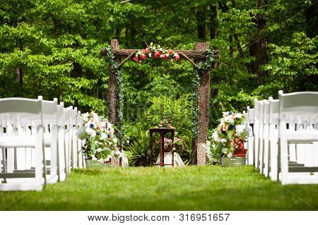 Summer Outdoor Wedding Ceremony Path With  Wooden Arch