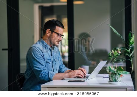 Serious Pensive Thoughtful Focused Young Casual Businessman Or Entrepreneur In Office Looking At And