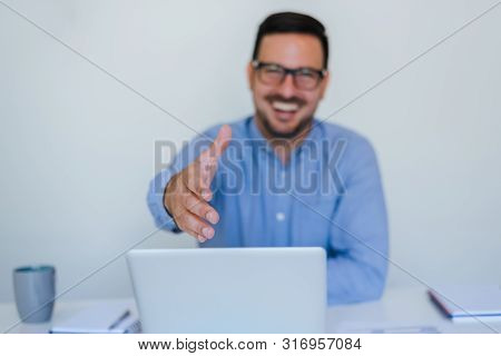 Handsome Cheerful Smiling Young Businessman Entrepreneur Manager Or Business Partner Offering Hand F