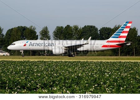 Amsterdam / Netherlands - July 3, 2017: American Airlines Boeing 757-300 N198aa Passenger Plane Taxi