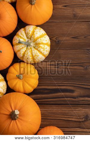 Many orange pumpkins on wooden background , Halloween concept , top view with copy space