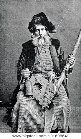 "Algerian Jew, spinning wool. Engraving by  Shyubler . Published in magazine ""Niva"", publishing house A.F. Marx, St. Petersburg, Russia, 1888 poster"
