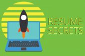 Writing note showing Resume Secrets. Business photo showcasing Tips on making amazing curriculum vitae Standout Biography Launching rocket up laptop Startup Developing goal objective. poster