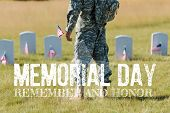 cropped view of military man holding american flag near headstones in graveyard with memorial day, remember and honor illustration poster