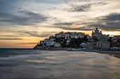 Spectacular sunset over Porto Maurizio, a small village in the Province of Imperia poster